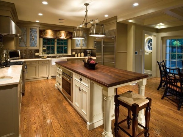 calming-brown-wall-paint-color-background-with-nice-white-wooden-kitchen-set-plus-white-lighting-idea-615x461